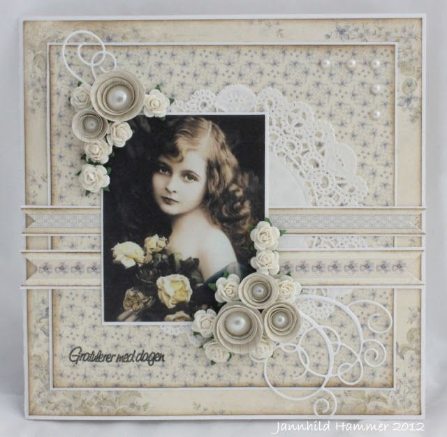 This lovely monochromatic heritage portrait page has great textural elements with a subtly patterned background, doilies, pearl studs, dimensional flowers and scrolls for interest...just beautiful. ♥