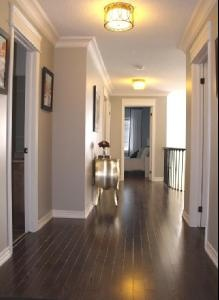 Love the dark flooring and crown molding! Paint color: Benjamin Moore Revere