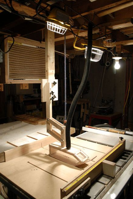 Over blade dust collection for table saw.