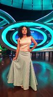 Pearle maaney wearing a turquoise coloured mermaid skirt with a white plain top