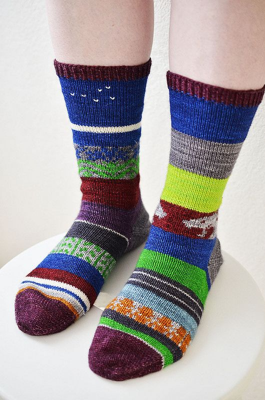 """Scrap Yarn Advent Calendar Socks: Striped socks knit out of yarn scraps (and also some amounts less than what qualify for """"scraps"""") according to daily clues between December 1st and 24th."""