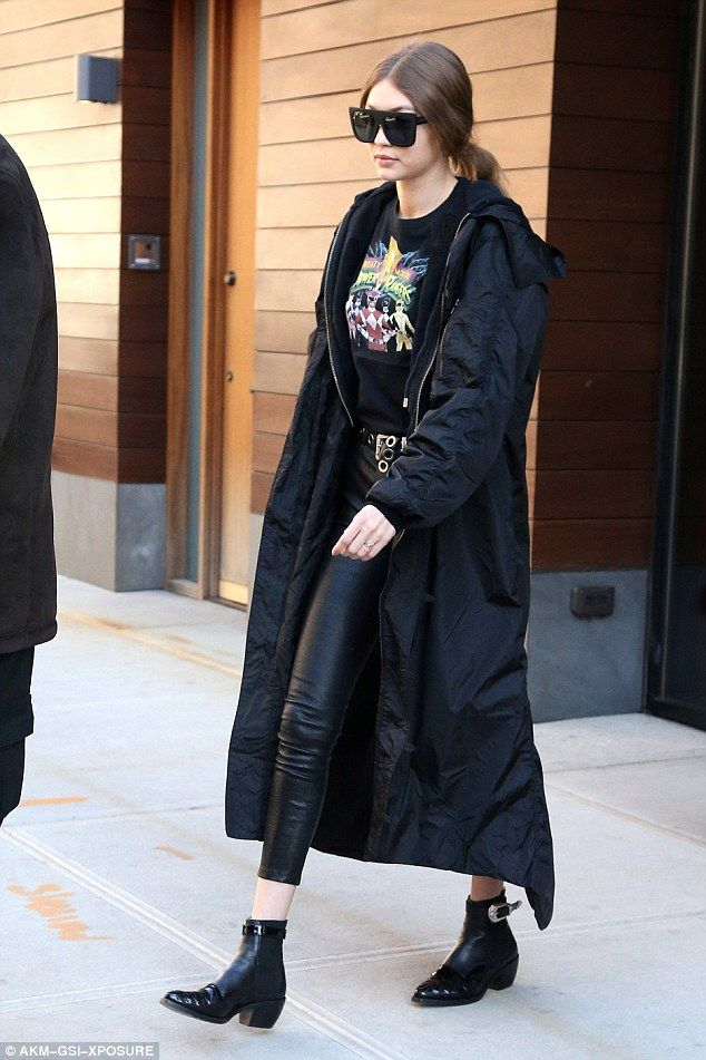 Chic: She accessorised with a matching black leather belt featuring large  holes and a pair