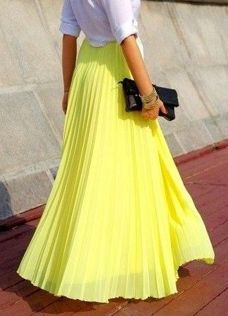 A refreshing burst of color with a yellow pleated maxi skirt.