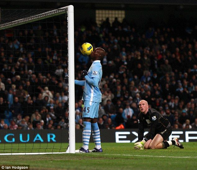 Dec. 3rd. 2011: Mario Balotelli makes it 4-1 as he chests the ball into an empty net as Norwich's John Ruddy watches on after he could only parry Balotelli's first shot