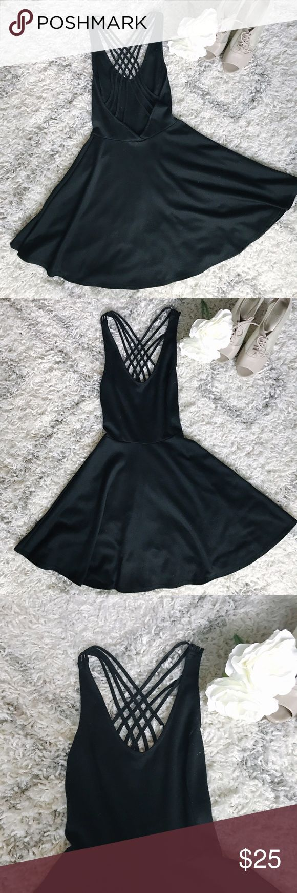 Lush Black Skater Dress w/ Low Criss-cross Back The perfect LBD by Lush (sold at Nordstrom). Skater dress cut gives this dress nice flow. Amazing criss-cross back. Falls above the knee. 88% polyester. 8% rayon. 4% spandex. Size XS. Lush Dresses Mini