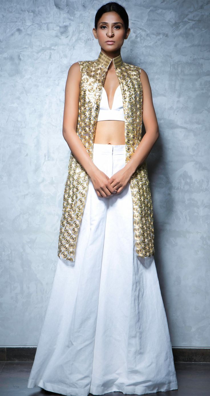Embroidered long vest with short linen blouse and wide linen pallazo pants by NIKHIL THAMPI http://www.perniaspopupshop.com/lakme-fashion-week/nikhil-thampi/nikhil-thampi-embroidered-vest-with-pallazos-and-crop-top-nktlfw081308.html