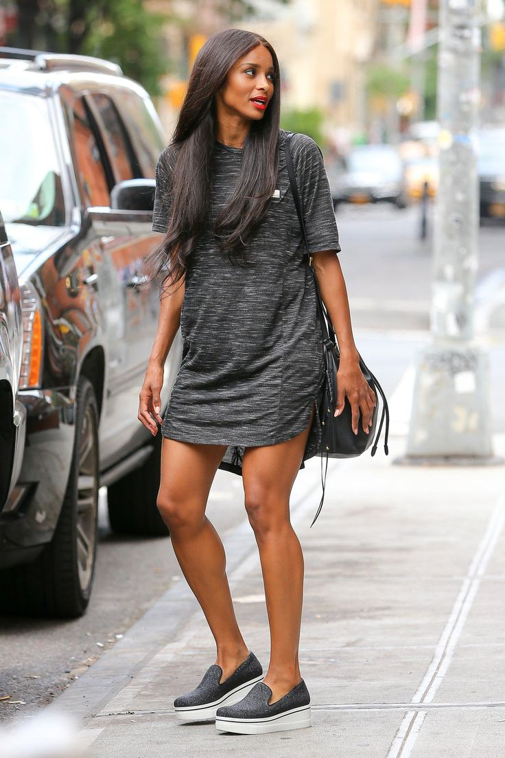 Ciara in a dark gray t-shirt dress and slip on sneakers
