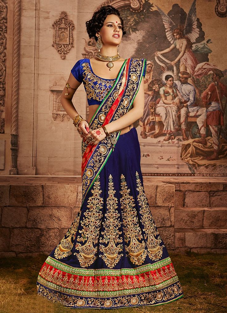 Shop this product from here.. http://www.silkmuseumsurat.in/blue-applique-work-velvet-lehenga-choli?filter_name=4627  Item :#4627  Color : Blue Fabric : Velvet Occasion : Bridal, Party, Reception, Wedding Style : A Line Lehenga Work : Embroidered, Patch Border, Resham