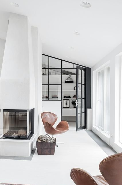 1800s Country Homes: Fireplace And Angled Glass Wall And Door