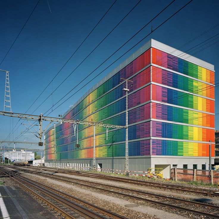 Am Rietpark D Office building by SLIK Architekten in Switzerland. The one layered multicoloured facade was designed and constructed with sustainability in mind while making a strong artistic statement.