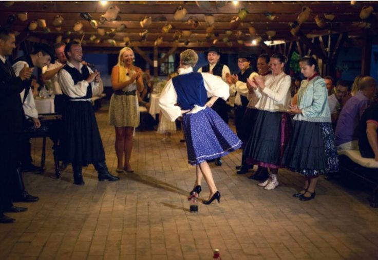 Authentic Hungarian wedding in folk dress - countryside style. A lot if: - food; - pálinka (alcohol); - dance;  - fun! More photos: http://www.hungarianweddings.com/Photos/Pages/Lisa_%26_Alex__Big_Fat_Hungarian_Wedding.html#108