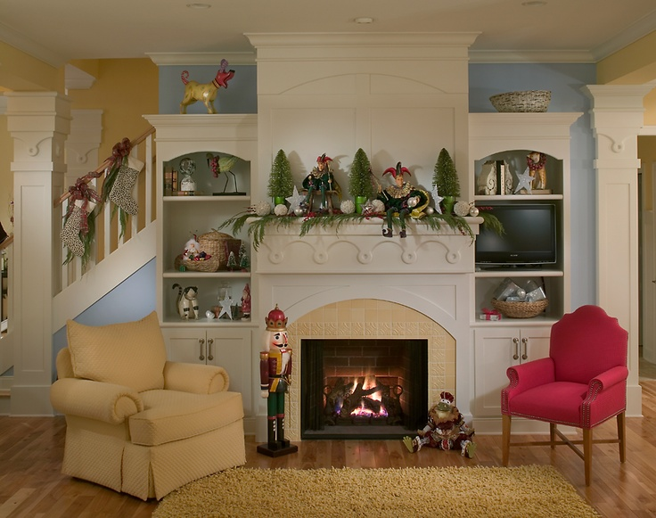 Coastal fireplace dressed for the holidays designed by