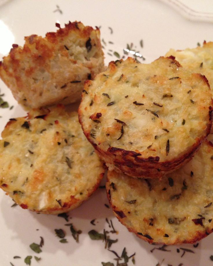 "Mini pizza bites: Mini cauliflower pizza bites Cauliflower Pizza Bites ""1 medium head of cauliflower 1 extra large egg plus one egg white 1/4 cup low fat cottage cheese 1/2 cup parmesan cheese 1 teaspoon dried oregano 1 teaspoon dried thyme 1/2 teaspoon garlic salt fresh ground black pepper, to taste"""