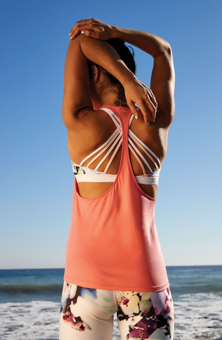 We're currently crushing over this lightweight coral tank and strappy back bra.   CALIA by Carrie Underwood
