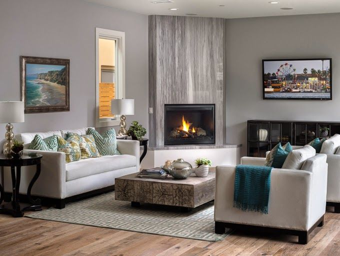 Great corner fireplace with combined focal points using TV nearby. House of Turquoise: RUHM Inc.