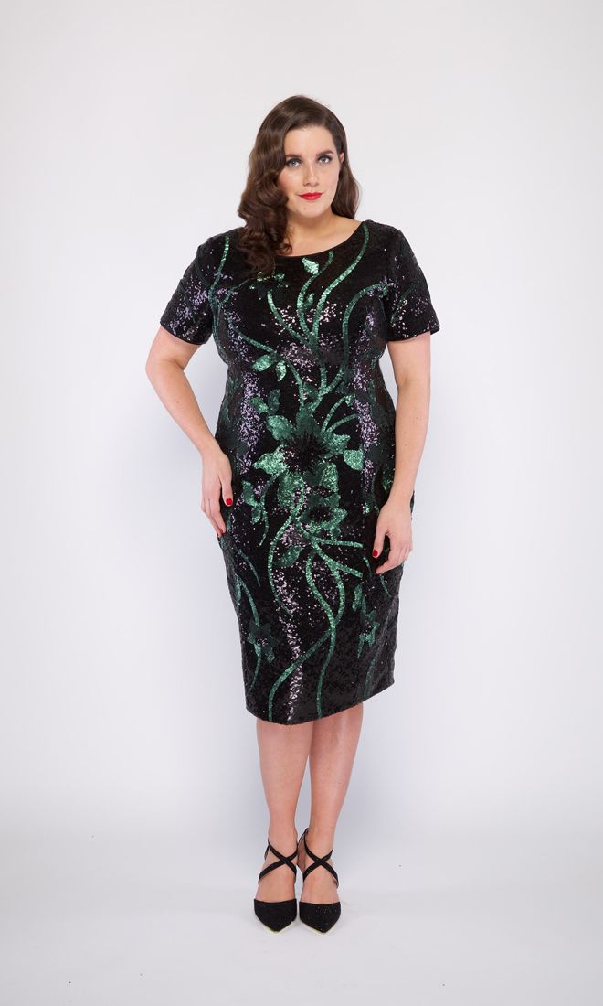 The CAROLINE cocktail dress is a fully sequinned cocktail length dress with a floral style design. Form fitting and elegant for plus sized ladies!