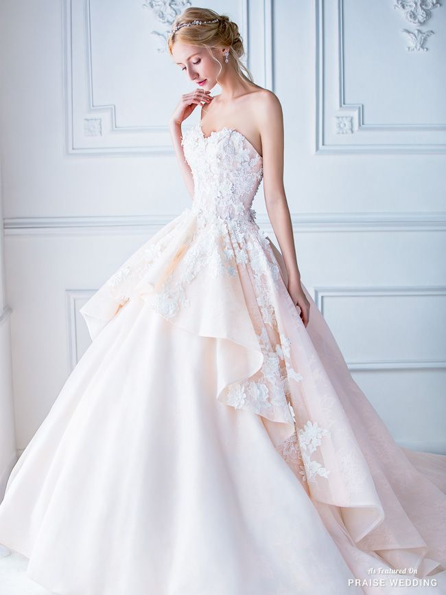 Love at first sight with this pastel peach gown from Digio Bridal!