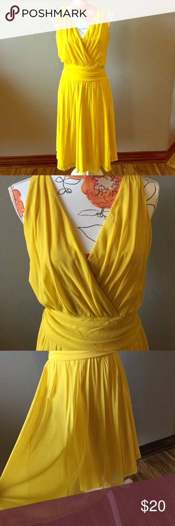 Mustard yellow dress Size 12 Lovely mustard dress with flattering waist and feminine style. Wore a few times and I got so many compliments! Soft gauzy material with a little stretch. Fully lined. Newport News Dresses