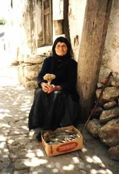 Old greek lady in Crete. After the loss of the husband, Greek women dress in black. All memories of my Yiayia is her dressed in black.