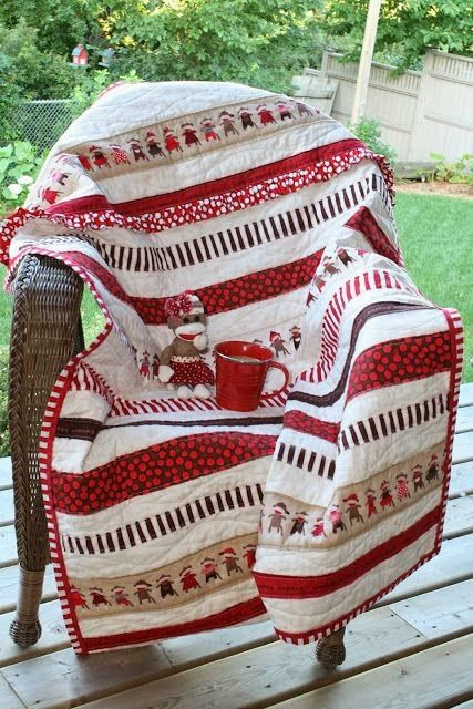 Sock monkey quilt.  Like the simplicity.  A strip quilt as you go or even stitch in the ditch would make it pretty easy.  But very cute.