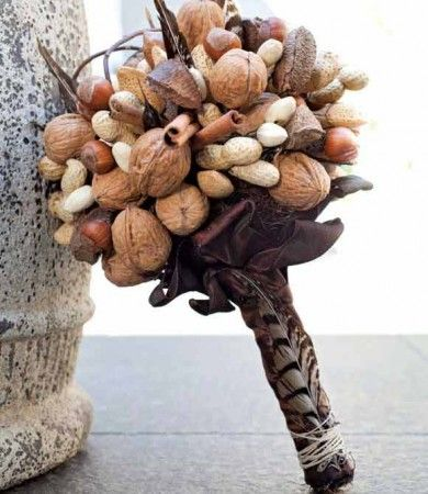 "Haha. The last thing I need is a ""handful of nuts"" right before we ""cut the cheese"" (wheel wedding cake). #edible #wedding #bouquet"