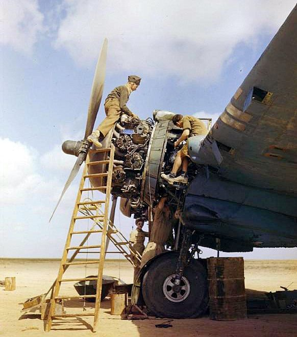 Royal Air Force ground crew overhauling a Bristol Beaufighter's Hercules engines at Magrun