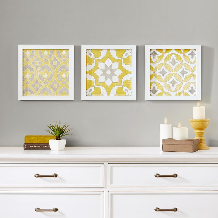 Tuscan Tiles will add a pop of color in any desired room. The three piece set features a Moroccan inspired pattern in a vibrant yellow, crisp white and cool grey. The art is printed on paper and gel coated for texture and finished off with a white frame.