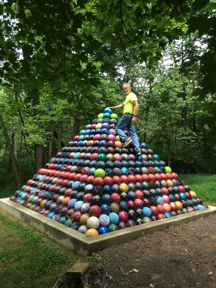 Over the past 15 years my dad collected 1785 bowling balls and built a giant Bowling Ball Pyramid