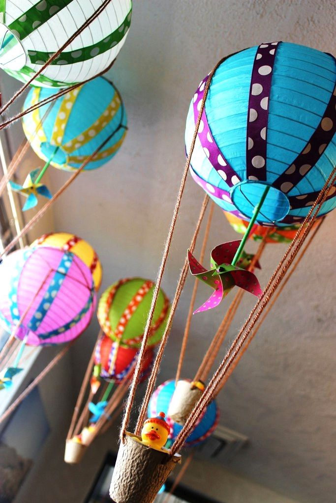 Adorable hot air balloons made from lanterns and rubber duckies! You can pick whatever colors you need to match.