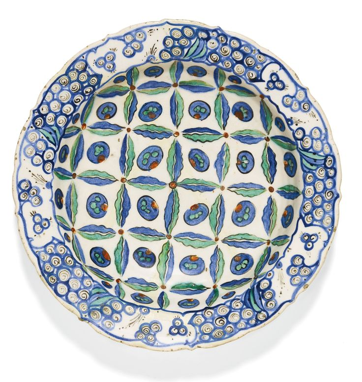 An Iznik polychrome pottery dish with stylised cloud and cintamani design, Turkey, circa 1580-85 | Lot | Sotheby's
