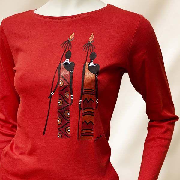 Camiseta Clásica Manga larga. Diseño: Dos Masai. Color Naranja. Esta prenda ha sido pintada con Pinturas para tela, inalterables en el lavado tanto a mano como en lavadora. Confeccionada en 100 % Algodón, su tejido es muy suave al tacto. Está disponible en variedad de colores y tallas. Para colores o dibujos diferentes a los que figuran en stock, consultar con el taller. Tejido: 100 % Algodón. Lavado a  máquina: 30° Máx. Plancha: calor medio. No usar lejía ni secadora.