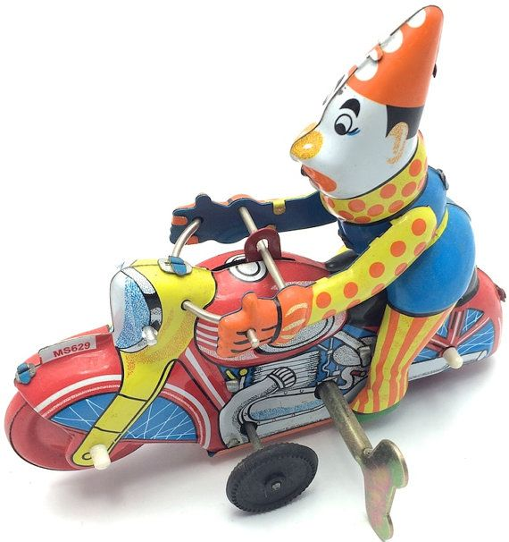 Vintage wind-up tin toy acrobatic circus clown by GiftlandDeco