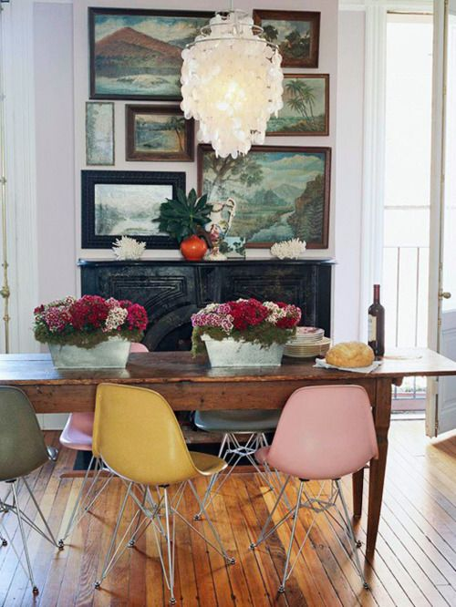 Assemblage of paintings and mismatched chairs