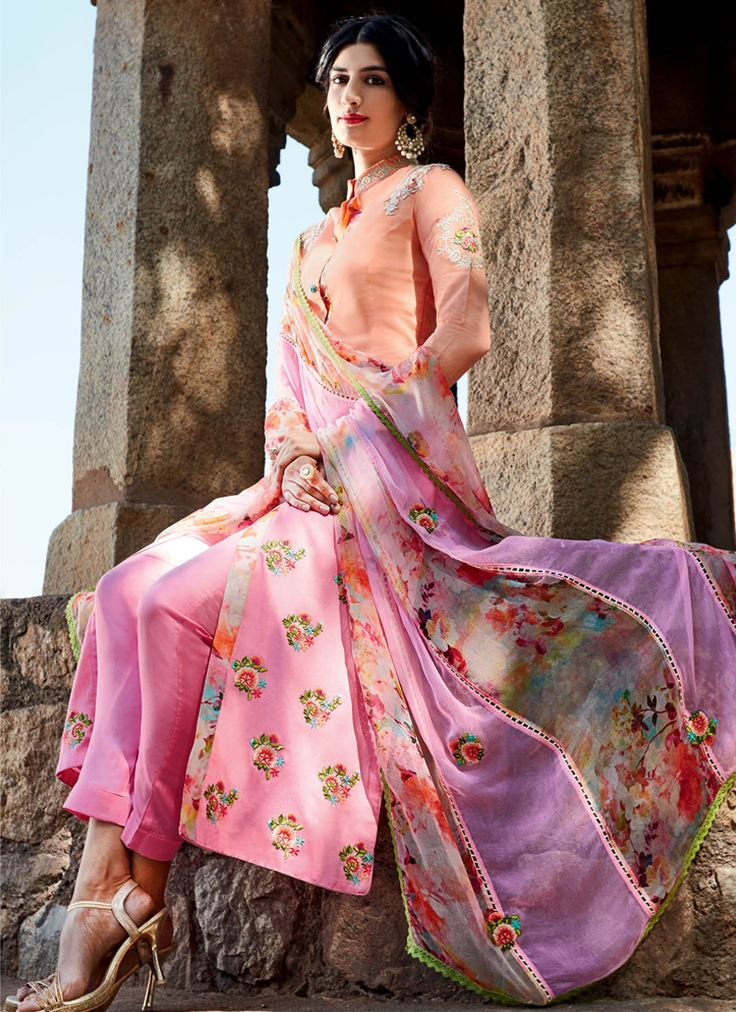 Featuring amazing peach and pink designer suit elegantly crafted with floral motifs resham embroidery. It is paired with matching unstitched bottom material and digitally printed chiffon duppata.This  suit can be stitched upto size 46. For stitching enquiries, please email us at customercare@hunard…