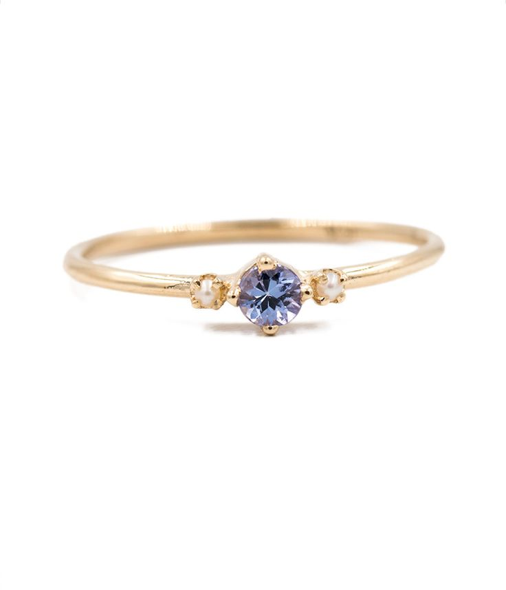 Tanzanite with Side Pearls Ring. Literally everything I want in an engagement ring!