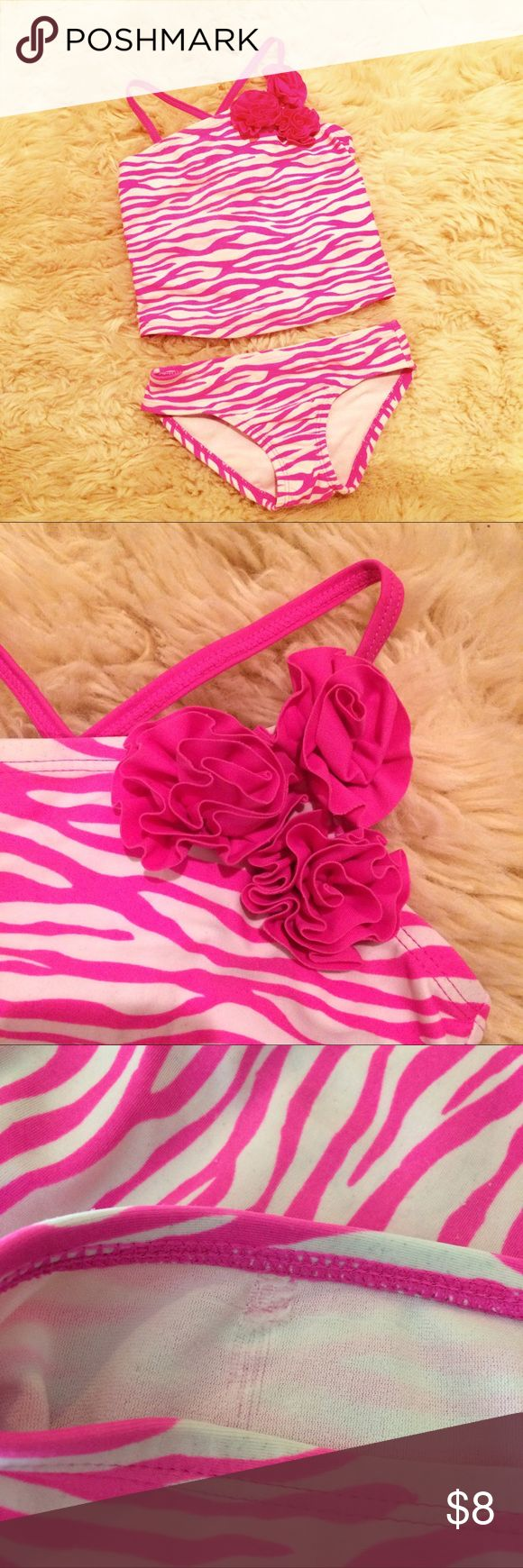 Girls' Punk Zebra Stripes Tankini Bathing Suit Super cute 2 Piece tankini Swimsuit in gently used condition. There is a flaw on the inside of the bottom that is not noticeable when worn (see 3rd pic) size 4 Swim