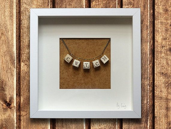Cute rustic welsh Cwtch strung wooden blocks white box frame. Signed by craft artist Craig Ollerton.
