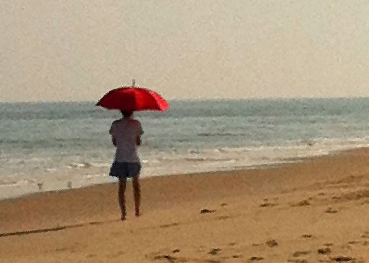 Woman with a Red Umbrella on the Beach