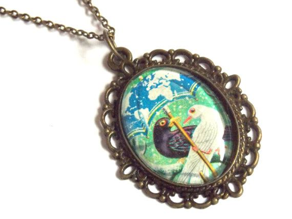 #cute #bird #black and #white #pigeon #couple under the #blue #umbrella while #snowing <3 #turqoiuse background and #worldmap of #snow - on the umbrella! #original #vintage #paper #bronze #oval #pendant #necklace #madeoflove jewelryagnes.etsy.com