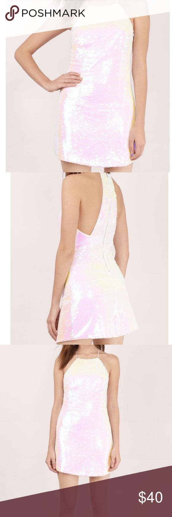 White Sequin Dress White iridescent sequin dress! So cute! I got it for my bachelorette party and it was unfortunately too small. So sad but want someone else to enjoy it!! Never been worn Tobi Dresses Mini