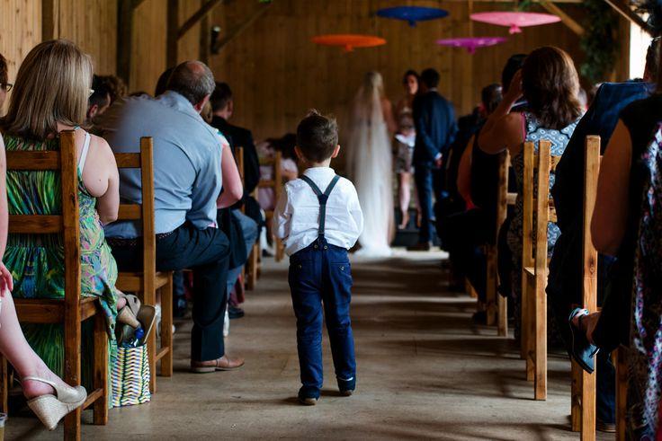 Little boy watches festival wedding ceremony Cambridgeshire