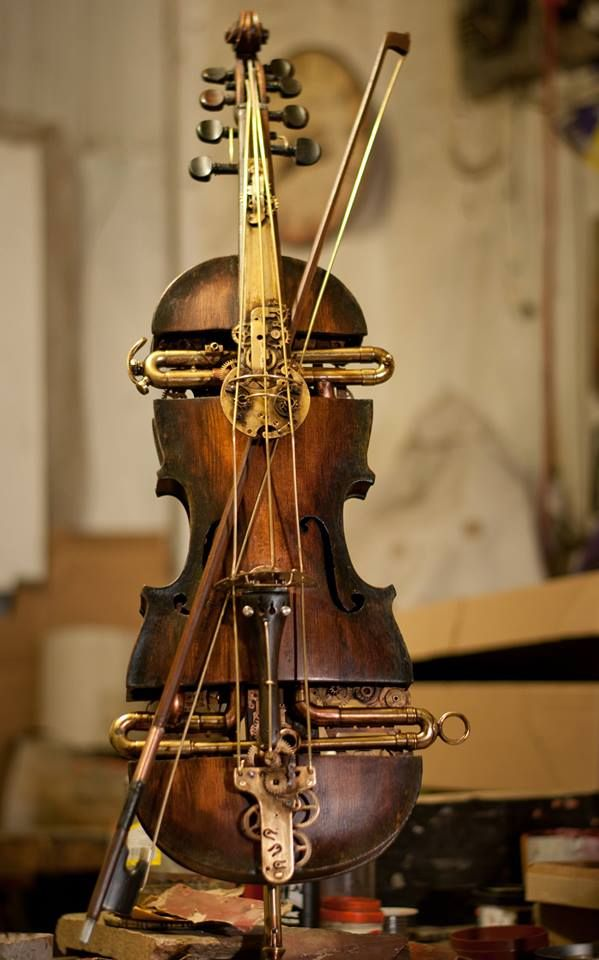 Steampunk music style. So, this isn't really worth anything as an instrument, but it's pretty ;) (and, I hope the violin was beyond repair...)
