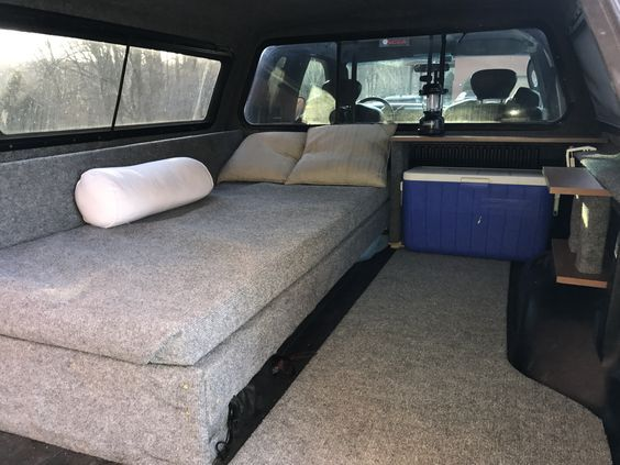 Now THIS is a truck bed conversion!  A bed, a place for our cooler and some shelves.  Basically roll in, do your thing, and you are ready for sleep whenever! #camping #truck #outdoors