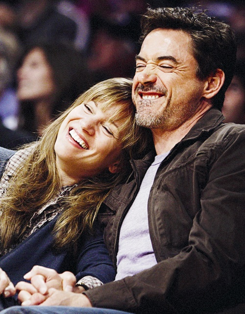 Susan Downey and Robert Downey Jr. at a Lakers game
