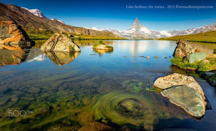 Lake Stellisee, the vortex - Lake Stellisee with the Matterhorn massif. Water vegetation in motion. Swiss Alps. ©www.albertoperer.com