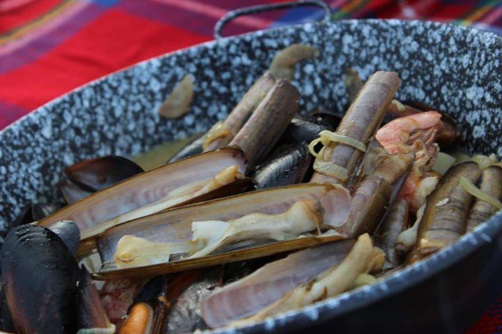 Razor clam grill picnic  in Liguria, Italy