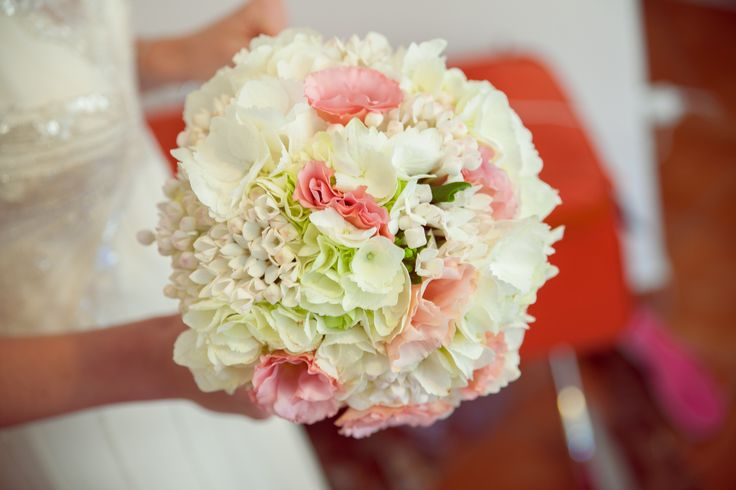 White hydrangeas, pink lisianthus, white bouvardia fresh flowers bouquet.