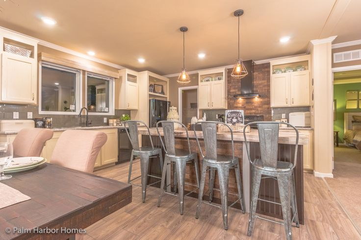 Fabulous eat in kitchen with large island in Palm Harbor's The Urban Homestead FT32563C is a manufactured home of 1,736 Sq. Ft. with 3 bedroom(s) and 2 bath(s). Large kitchen island. Kitchen pantry. Trey ceiling in master bedroom.