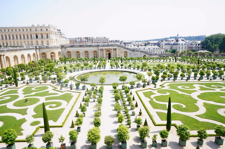 Learning about some amusing stories regarding Louis XIV and the orange groves at Chateau de Versailles, Versailles, France.