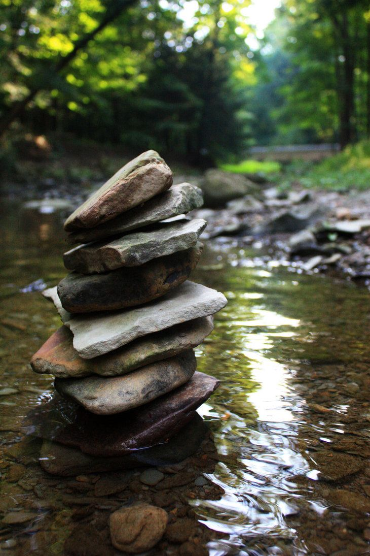 cairns in flowing water